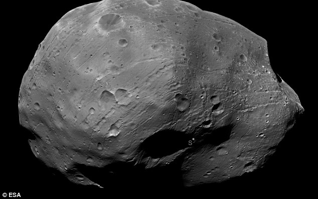 Martian moon: Taken by Europe's Mars Express probe earlier this month, this image has been photometrically enhanced to illuminate the darker areas of Phobos, one of the least reflective bodies in the solar system