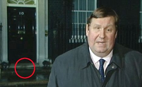 Rat it again: The rodent scurries past in the background as BBC reporter Gary O'Donoghue reports last week