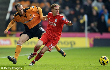Failed to settle on Merseyside: Christian Poulsen (right) could be on his way out of Anfield