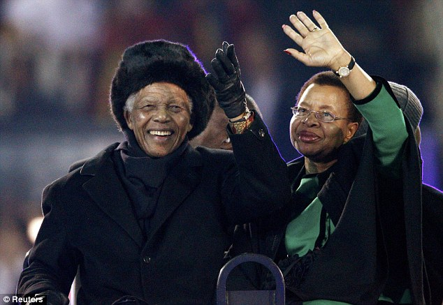 Concern: Nelson Mandela'slast public appearance at the World Cup Final in July, when he was ferried around the stadium in a buggy while joined by wife Graça Machel, who visited him in hospital yesterday