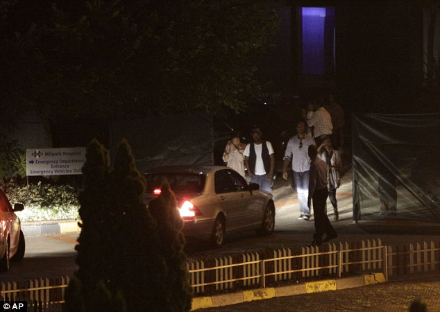 Worry: More relatives leaving the cordoned off area of the hospital car park last night