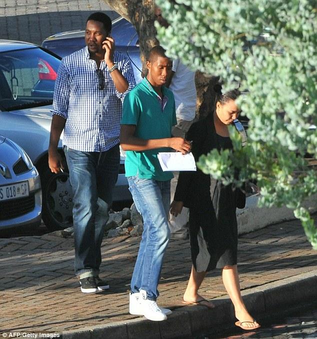 Concern: Some of Mr Mandela's grandchildren visiting the former president at Milpark hospital, Johannesburg