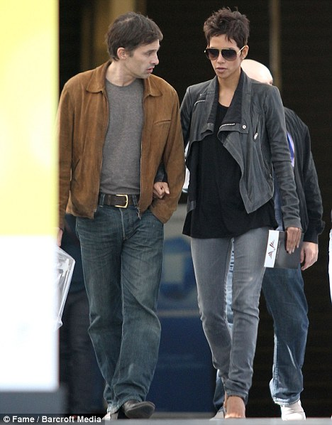 In demand: the actress, pictured with boyfriend Olivier Martinez last week, has signed on to five films over the next year