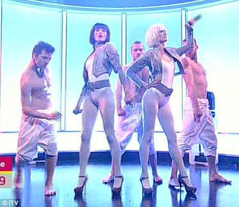 Space age: The girls tried to emulate Lady Gaga in their bodysuits and cropped bobbed wigs