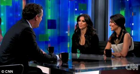 Not such a draw: Less than half a million people tuned it to watch Piers Morgan interview Kim and Kourtney Kardashian on his CNN show on Thursday night