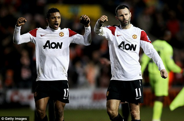 Still going strong: Giggs celebrates with Nani after United's dramatic win at Blackpool last week