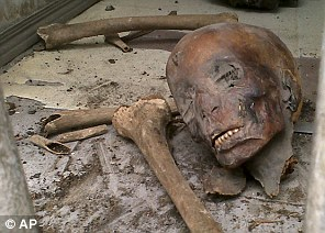 Smashed open: Looters targeted the world-renown Egyptian Museum and hurled mummy parts over the floor