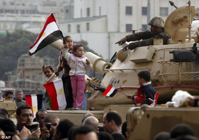 Youthful zeal: Young children climbed up on a tank to show the friendly nature of the protest