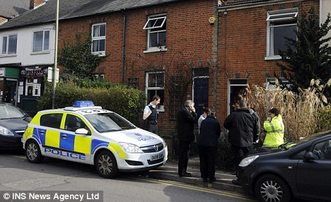 Officers at the house where Mrs Haines was found in the bath