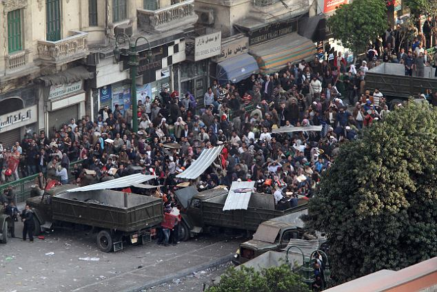 Clashes: Mubarak supporters take on anti-government protesters in Cairo today