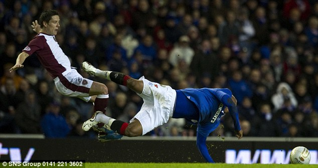 Welcome to El: Ian Black (left) goes in hard on Rangers new boy Diouf