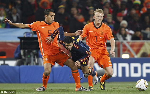 Doubling up: Holland's Giovanni van Bronckhorst and Dirk Kuyt pay close attention to Pedro in the World CUp final