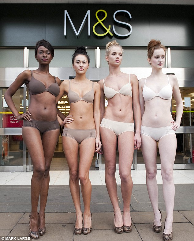 Nearly naked: M&S models brave the cold on Oxford Street in London to promote a new range of underwear