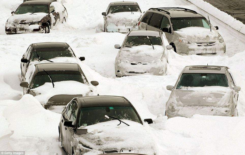 Going nowhere: Cars sit in the northbound lanes of Lake Shore Drive, Chicago, after accidents and drifting snow stranded the drivers during last night's blizzard.