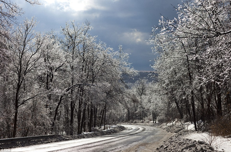 Beautiful but deadly: Ice-coated roads glint menacingly in the Pennsylvania sun after the storm yesterday
