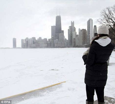 Hanna Conger takes a picture of the aftermath of the snowstorm that dumped over two feet of snow in Chicago