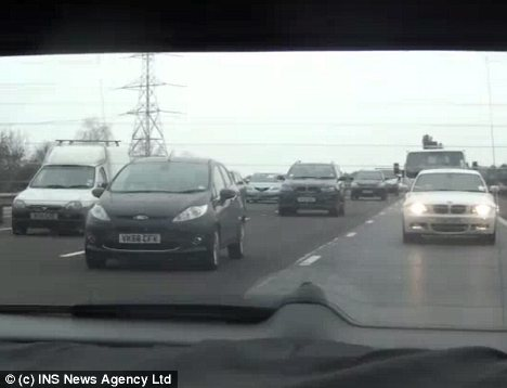 Tailback: Dozens of motorists were delayed by police who allowed Katie Price to drive off after they formed a rolling road block which lasted for around eight minutes