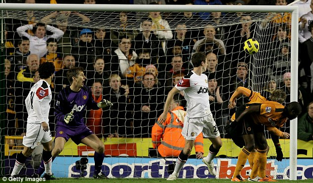 Hunting in packs: Wolves took the lead when Kevin Doyle and George  Elokobi both went for the same Nenad Milijas cross to head home for the home side.