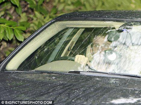 Lonely figure: Alex Reid was spied looking glum as her drove away from Katie's Surrey mansion last week