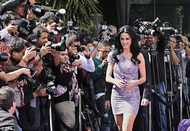 Not ready for her close up: The star donned an incredibly short, asymmetrical purple dress which showed off her enviably long legs