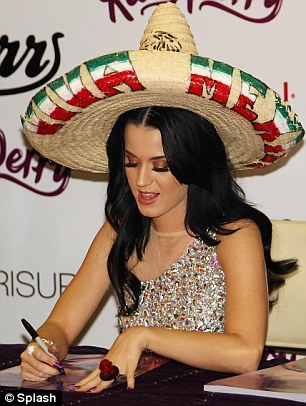 Olé! The singer was given a sombrero by a fan as she signed autographs