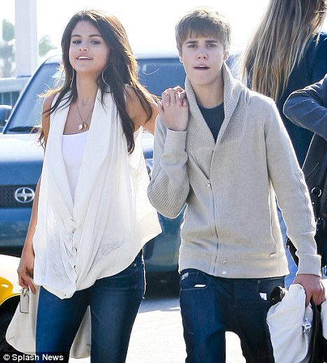 Caught! Justin Bieber and Selena Gomez are spotted holding hands during a stroll at Santa Monica Pier yesterday