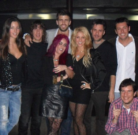 Joining in the fun: Shakira (centre, with blonde hair) was pictured next to Gerard Pique in this photo from his birthday celebrations