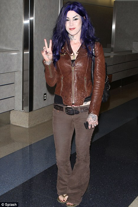 Purple passion: Kat Von D arrives at LAX airport yesterday sporting a brand new hairstyle