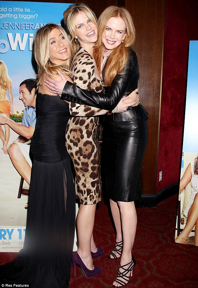 Model in the middle: The actresses cuddle up to co-star Brooklyn Decker at the New York premiere of Just Go With It