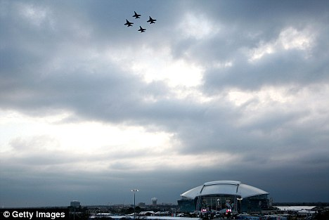 Taking flight: The U.S. Navy flyover has been criticised for costing $450,000 and going above a closed roof, although it has contested the figure