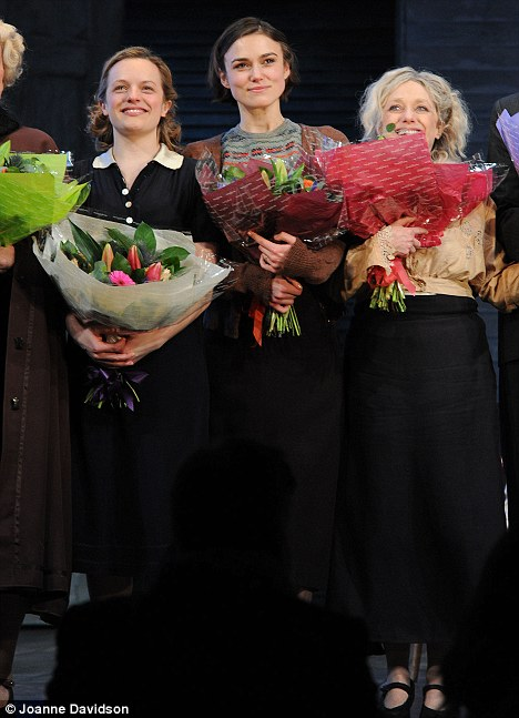 Floral tribute: Keira, Elisabeth and co-star Carol Kane (right) were presented with flowers during their curtain call