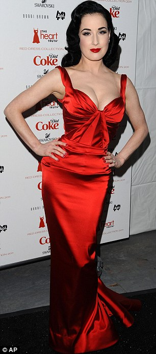 On fire! Dita Von Teese looked stunning in a bright red satin dress as she arrived at Heart Truth's Red Dress Collection during Mecerdes-Benz fashion week in New York City earlier this evening
