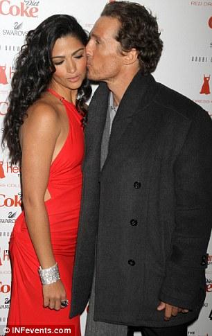 Sealed with a kiss: Matthew Mcconaughey plants a peck on girlfriend Camila Alves's cheek