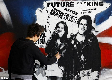 Finishing touches: Artist Rich Simmons perfects his mural which is displayed on London's Southbank