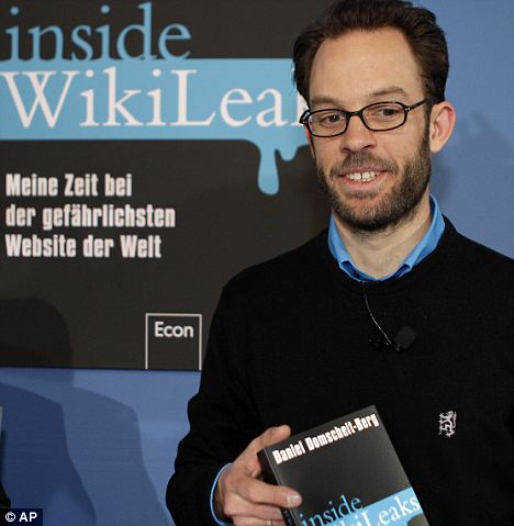 Criticism: Daniel Domscheit-Berg with his explosive new book at a press conference in Berlin, Germany, today. WikiLeaks is taking legal action against him