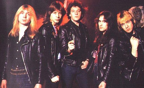 Glory days: Andrews, centre, pictured with Iron Maiden in 1981  before he was thrown out the band later that year
