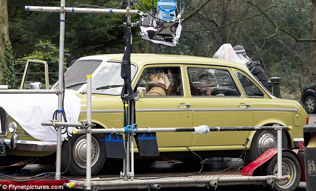 Family time: The Oscar winner gives Thatcher's daughter Carol, played by Olivia Colman, a driving lesson in the scene