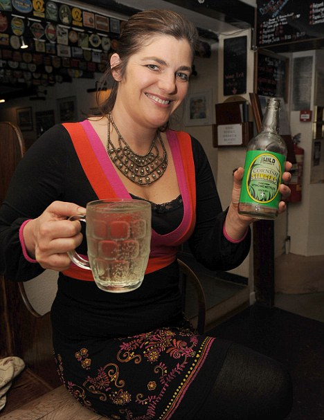 Stung for more tax: Barmaid Lisa Lea pours a glass of Cornish Stingers at the Trengilly Wartha Inn
