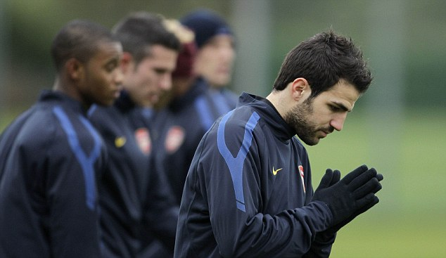 Livin' on a prayer: Arsenal captain Cesc Fabregas in training before their clash with Barcelona