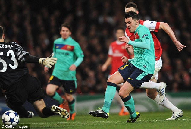 Through the legs: David Villa's composed finish put Barcelona ahead