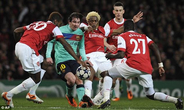 Somebody stop him: Arsenal players crowd around Messi (green)