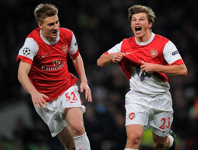 Getting shirty: Arshavin (right) celebrates with Bendtner after firing Arsenal in front