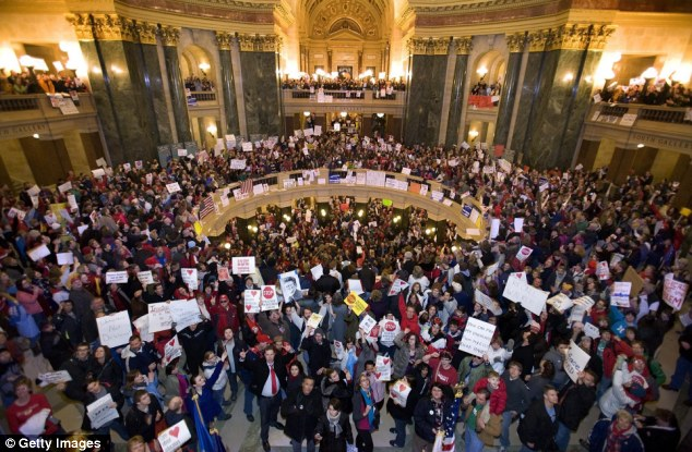 Protest: Teachers and others fill the State Capitol building in Madison, Wisconsin, demonstrating against a proposal to eliminate collective bargaining rights for state workers