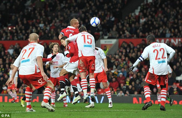 Goalden moment: Manchester United's Wes Brown rises above the defence head the ball into the net