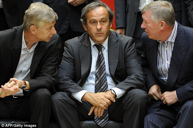 And how much did you pay for your seat?: Arsene Wenger (left) and Sir Alex Ferguson (right), quiz UEFA President Michel Platini