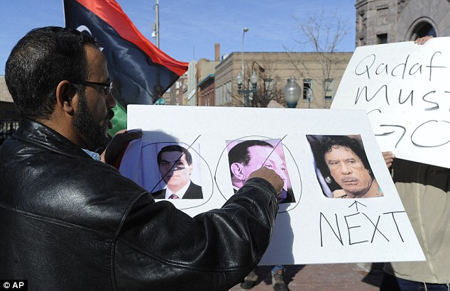 In line: A protester plays prophet and predicts the fall of Colonel Gaddafi