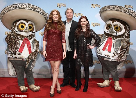 What a hoot: Isla, director Gore Verbinski and actress Abigail Bresli all posed with a pair of owls dressed as Mariachi