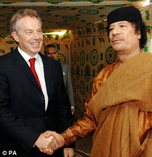 Risky ally: Former British prime minister Tony Blair did a deal with Colonel Gaddafi back in 2004