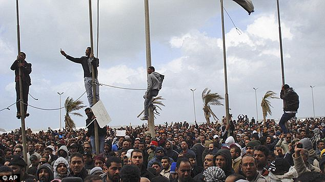 Mass movement: Protesters assemble in Benghazi as the fighting continues
