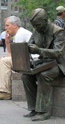 Bronze statue of man with briefcase symbolising survivor of terror attacks of September 11th, USA, Manhattan, New York